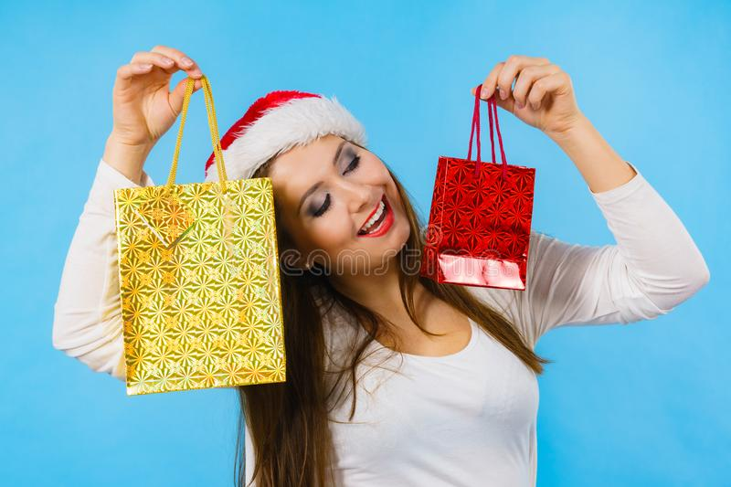 Happy Christmas woman holds gifts bag stock photo
