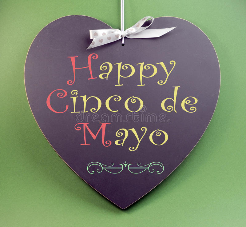 Happy Cinco de Mayo, 5th May, event reminder handwriting greeting on heart shaped blackboard stock photography