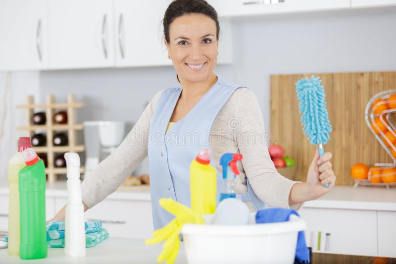 Happy cleaner girl with chestnut hair working royalty free stock images