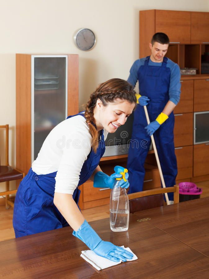 Happy cleaners cleaning in room stock photo