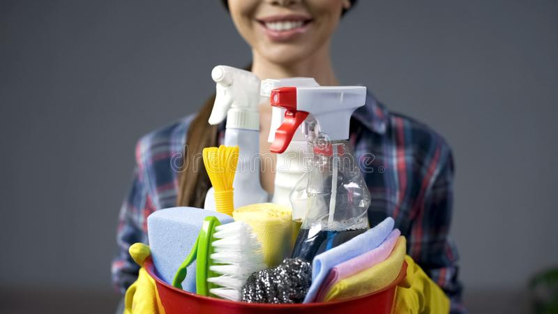 Happy cleaning service employee ready to start working, positive work attitude stock images
