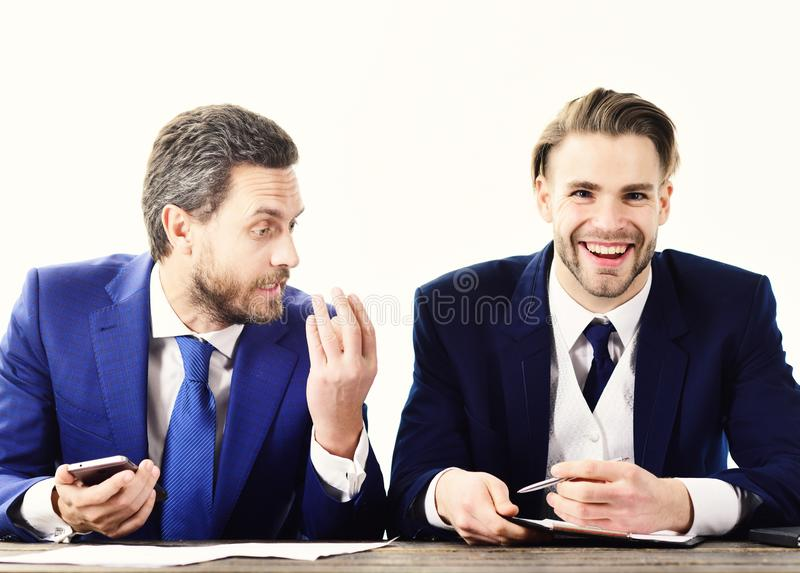 Happy client signs contract with realtor. Real estate agent and young businessman with smiling face. Sale manager and royalty free stock image
