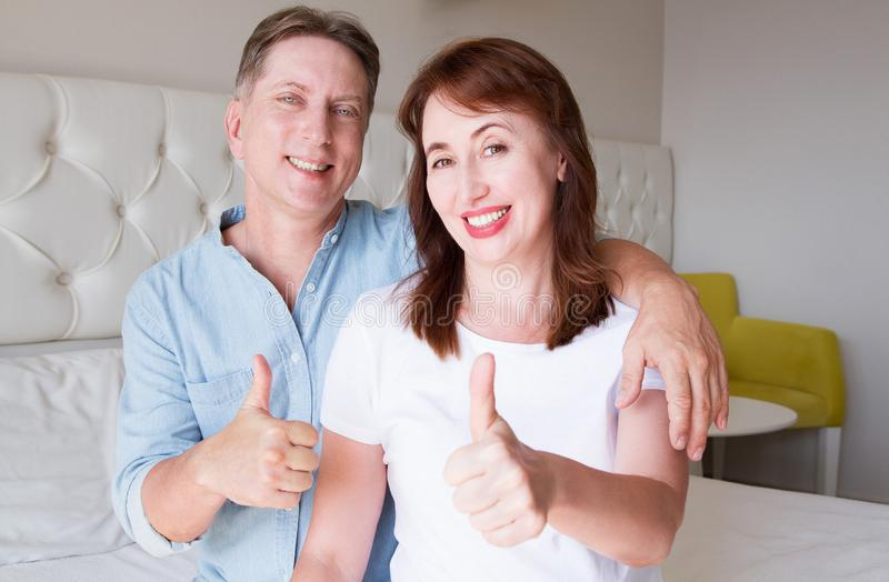 Happy closeup people faces. Smiling middle age couple at home. Family fun time weekend and strong love relationship. Healthy smile royalty free stock photo