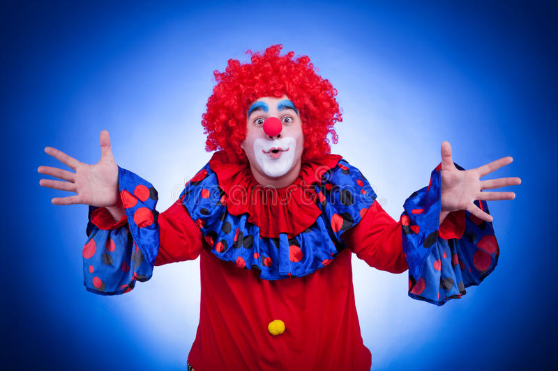 Happy Clown On Blue Background Stock Photo