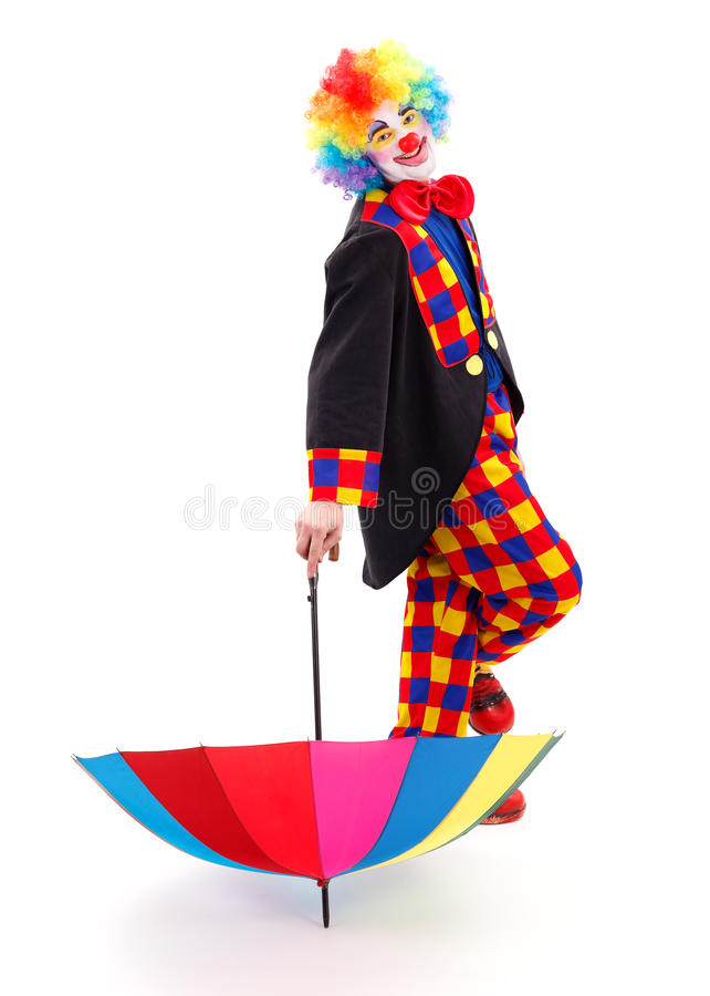 Happy clown with umbrella royalty free stock photos