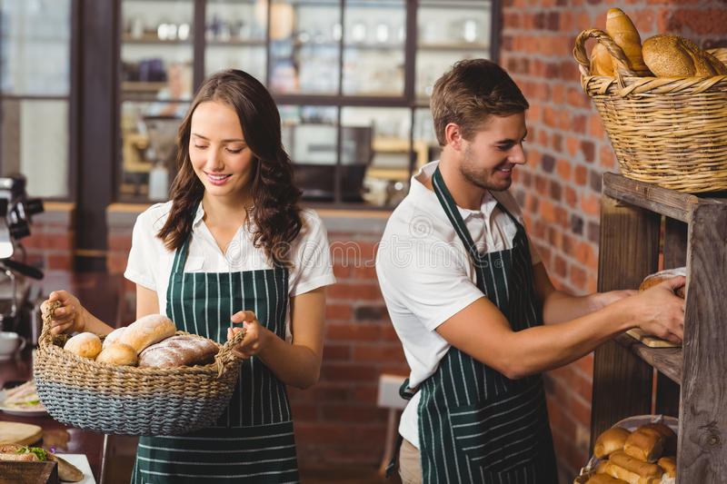 Happy co-workers working with a smile. At the coffee shop royalty free stock image