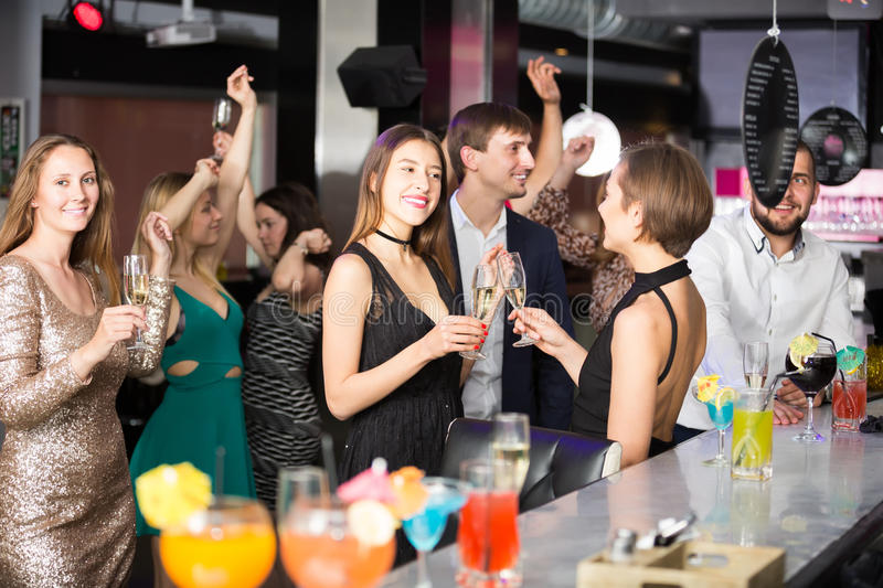Happy colleagues dancing on corporate party. With alcohol in hands stock photos
