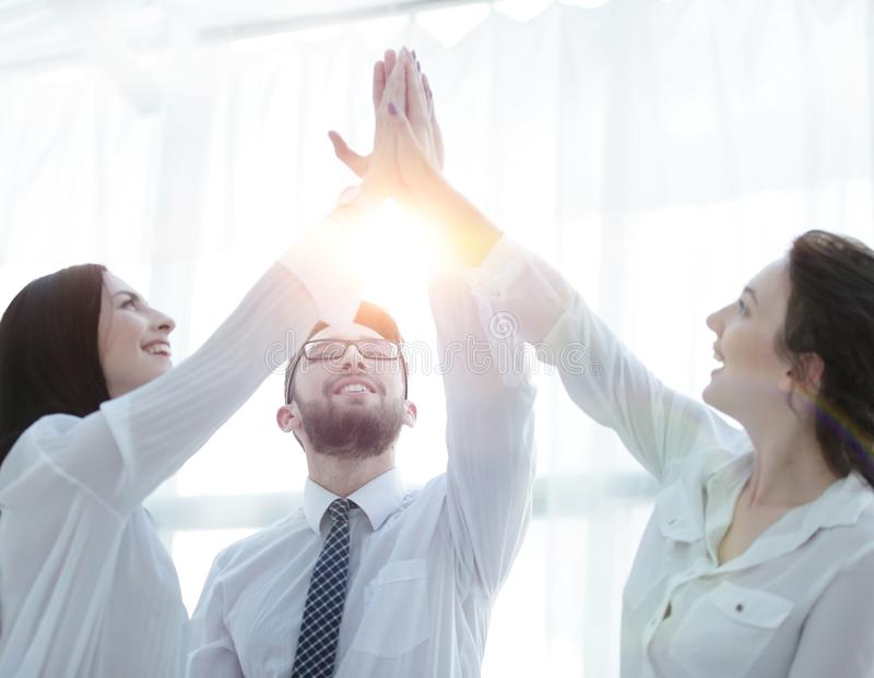 Happy colleagues giving each other a high five royalty free stock photos