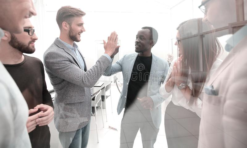 Happy colleagues giving each other a high five royalty free stock photography