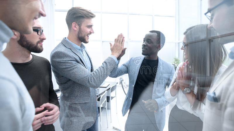 Happy colleagues giving each other a high five stock images