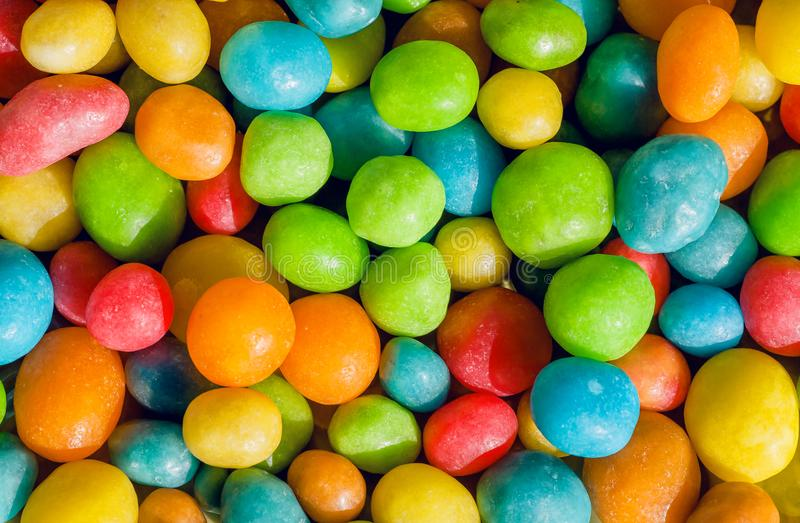 Happy colored sweets background. Many candy confection, small green, yellow, red drops. Bright texture royalty free stock photography