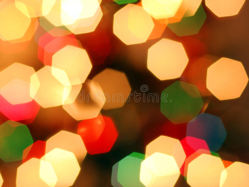 Happy and coloureful Christmas lights. The Christmas lights (also known informally as fairy lights) are the lights used for decoration around Christmas time. The royalty free stock image