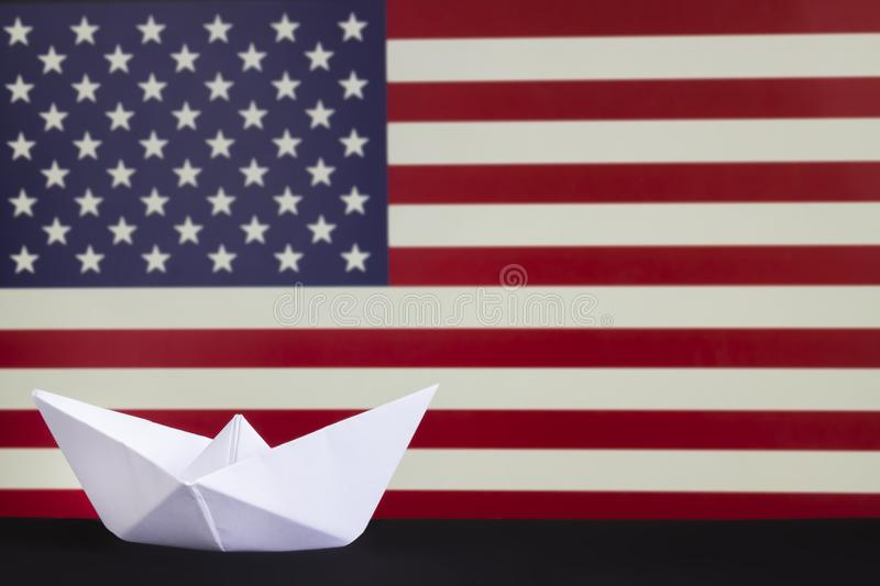 Happy Columbus Day, the great National USA holiday. Celebrated on the second Monday in October. White paper boat over blurred Amer royalty free stock image