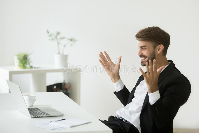 Happy company ceo satisfied with online achievement looking at l. Glad company ceo satisfied with achievement looking at laptop screen, excited businessman in stock photos
