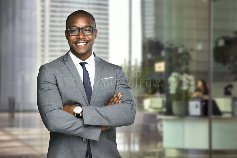 Happy company leader CEO boss executive standing in front of company building stock images