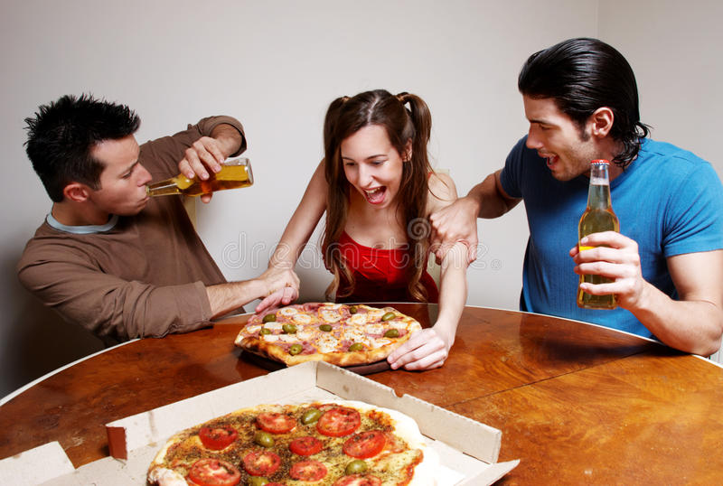 Download Happy Company Of Youth Eating A Pizza Stock Image - Image: 14691555