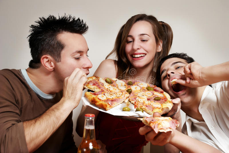 Download Happy Company Of Youth Eating A Pizza Stock Image - Image of pizza, adult: 14691635