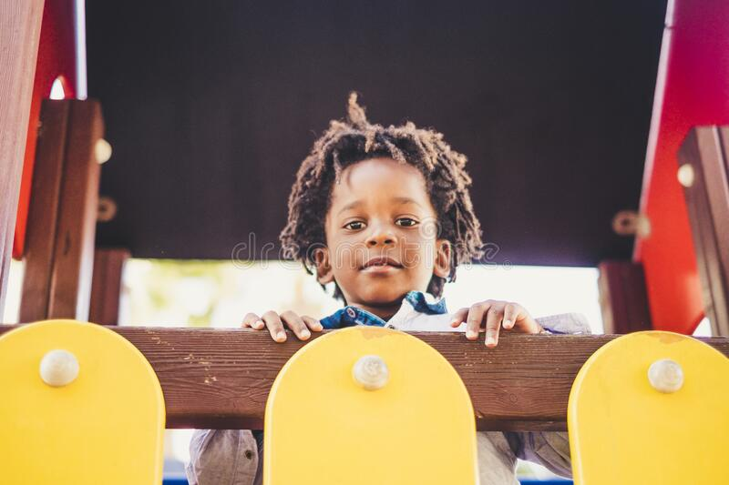 Happy concept with black children portrait at the park - happiness and playful three years old african kid looking with curiosity stock photos