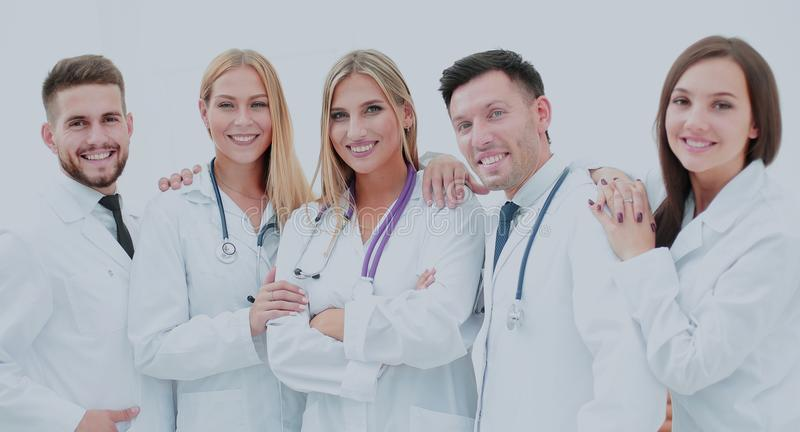 Happy and confident team of doctors posing on camera royalty free stock photography