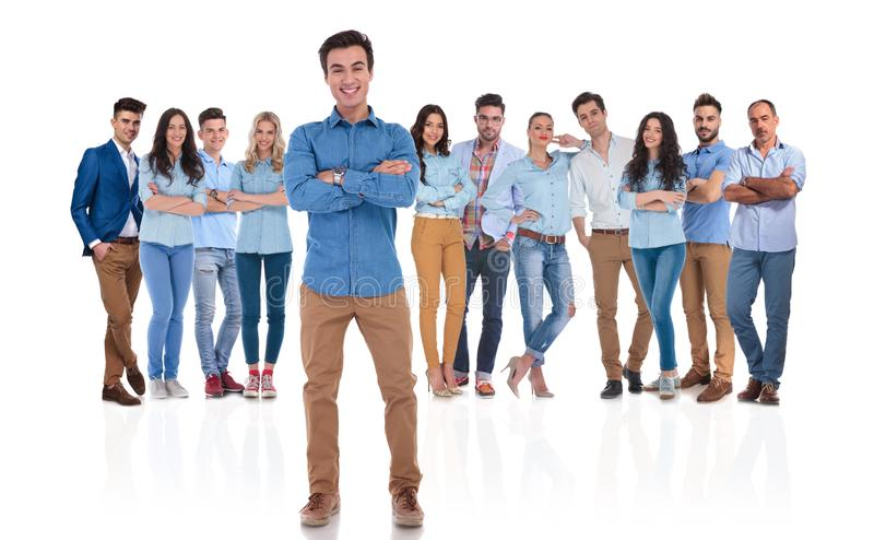 Happy and confident team leader in front of his group royalty free stock photography