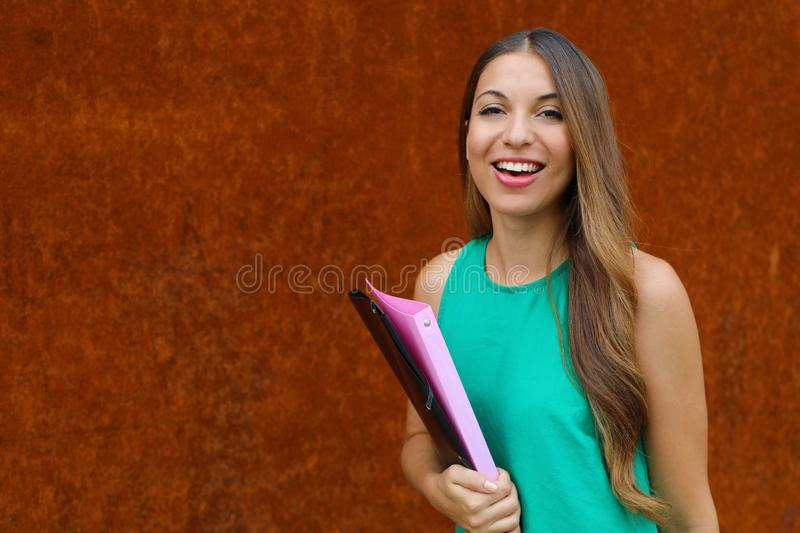 Happy confident young business woman looking at camera outdoor on rush background. Copy space stock images