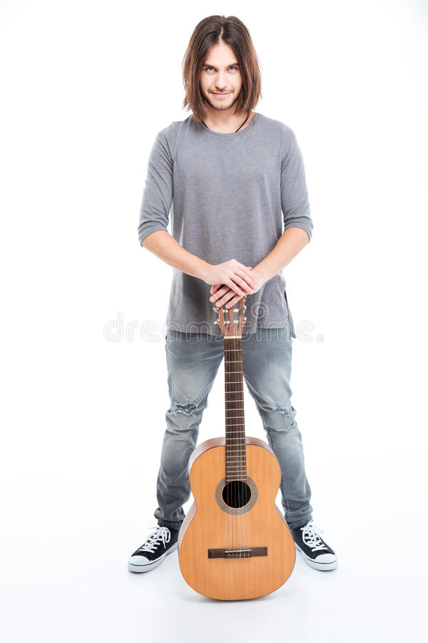 Happy confident young man standing with guitar royalty free stock photo