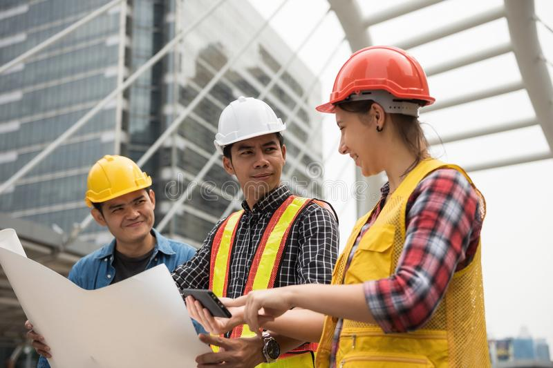 Construction team check plan from smartphone stock photo