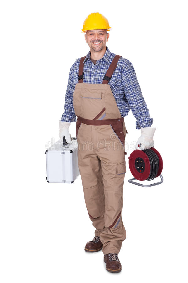 Happy Construction Worker. Holding Toolbox And Cable On White Background stock photos
