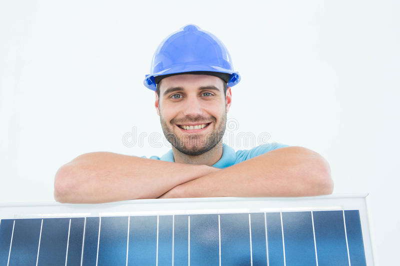 Happy construction worker leaning on solar panel stock photos