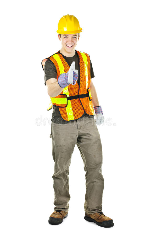 Happy construction worker showing thumbs up stock photo