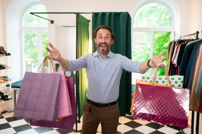 Happy contended cheerful active dark-haired bearded smiling man feeling emotional royalty free stock photos