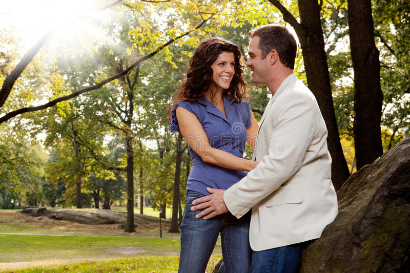 Happy Couple. A happy couple relaxing in the park stock image