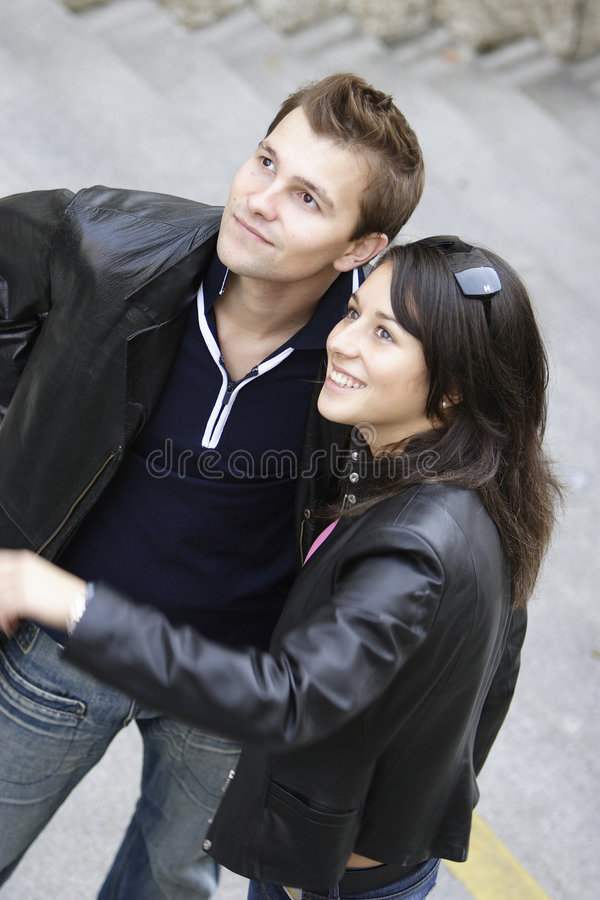 Happy couple. Looking at something interesting royalty free stock photography