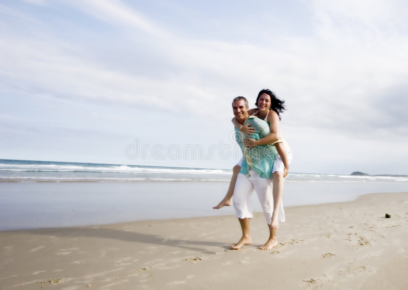 Happy couple. A happy married caucasian white couple enjoying their time together on the beach