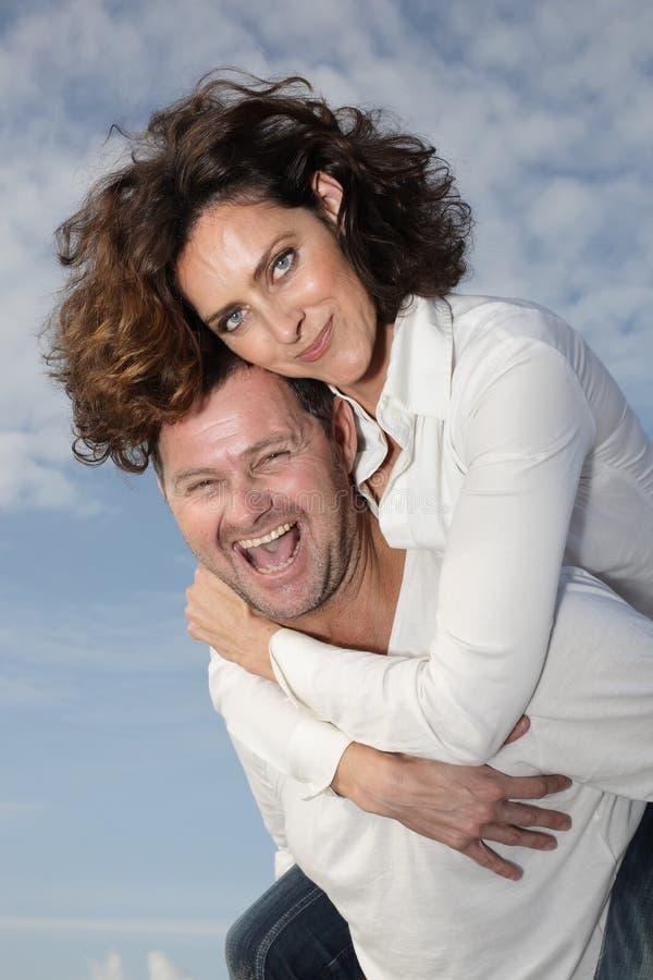 Happy couple. Beautiful couple with sky background stock photo