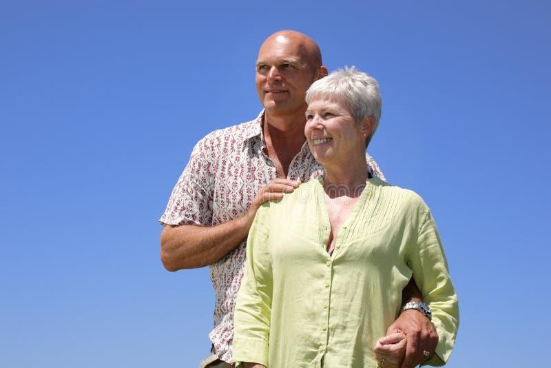 Happy couple. On sky background royalty free stock photos