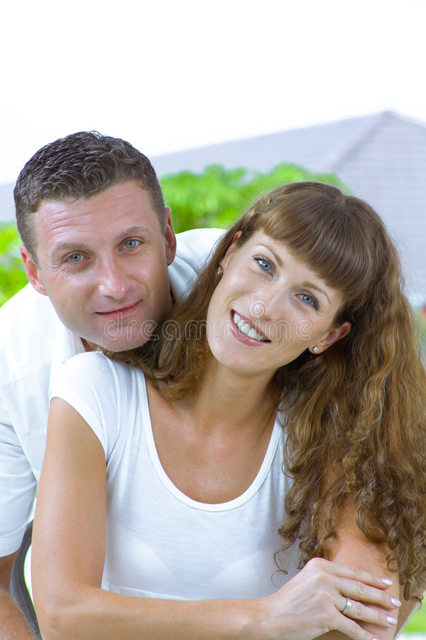 Happy couple. Portrait of nice young couple having fun together royalty free stock photography