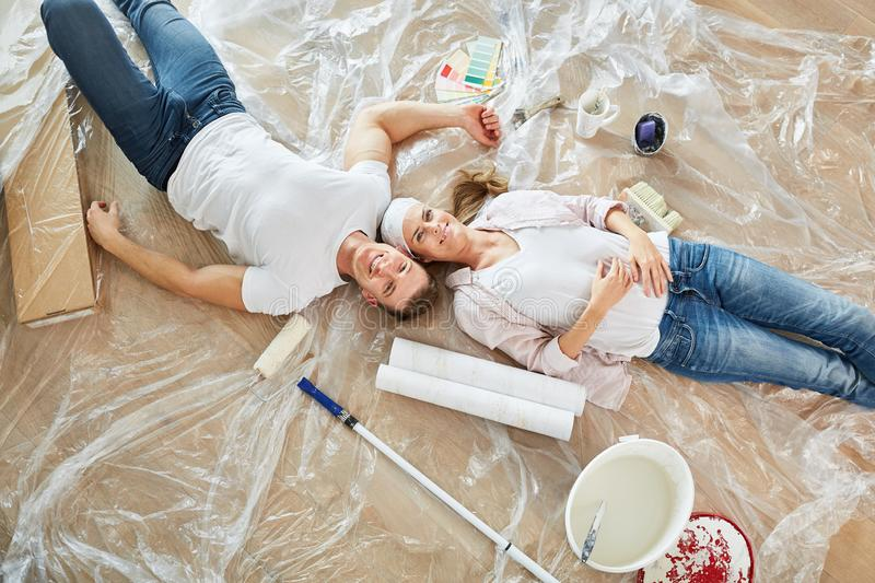 Happy couple as a home improvement is taking a break. While renovating in the new house royalty free stock photos
