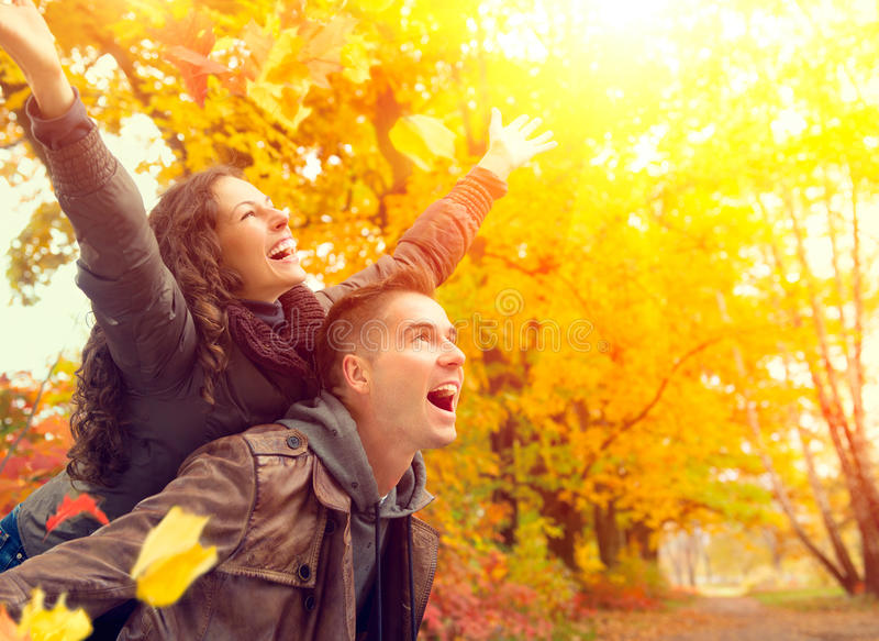 Happy Couple in Autumn Park. Fall. Family Having Fun Outdoors royalty free stock images