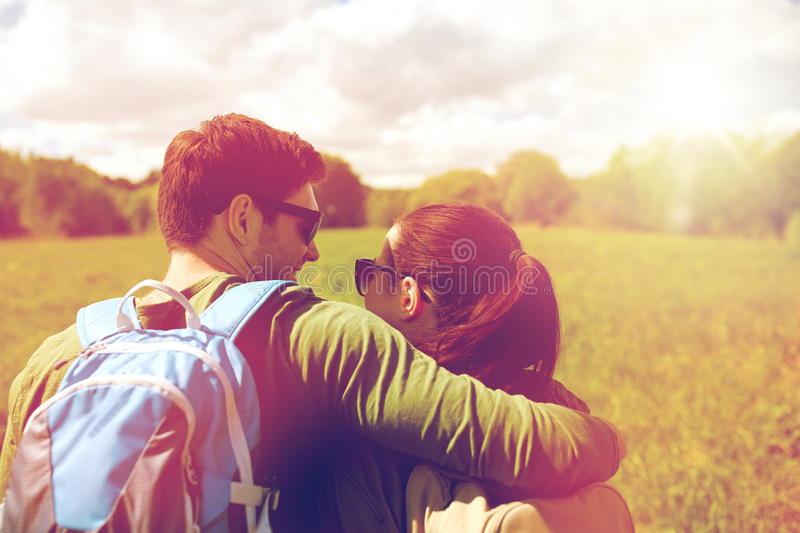 Happy couple with backpacks hiking outdoors royalty free stock image