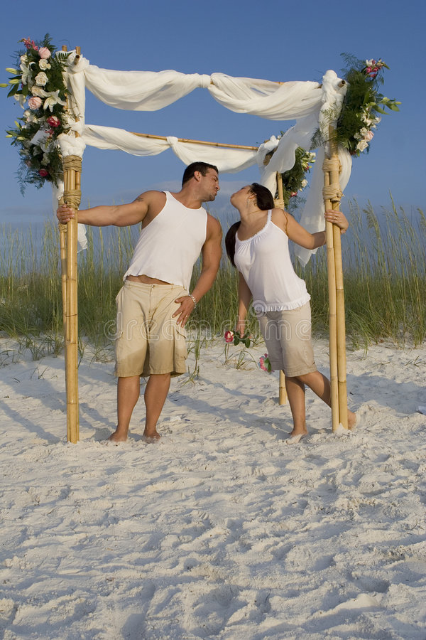 Happy couple on a beach stock image