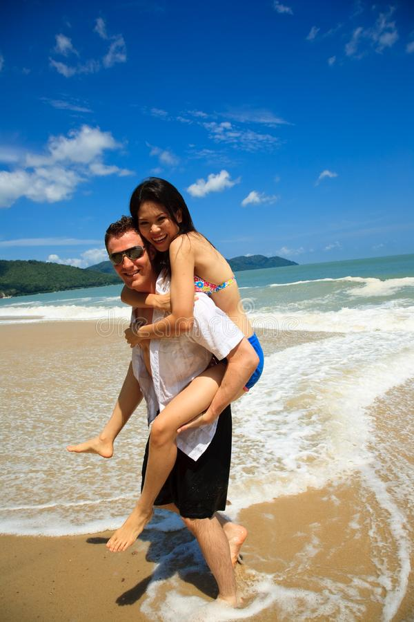 Happy couple by the beach stock photos