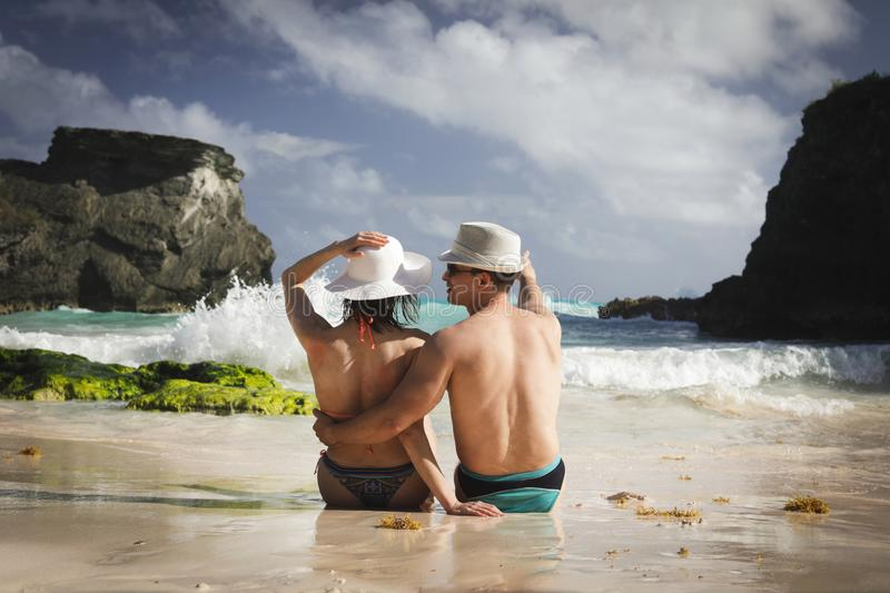 Man and woman on the beach. Happy couple on the beach on Bermuda, summer holidays or honeymoon background royalty free stock images