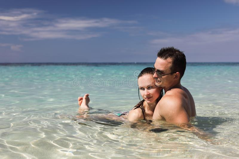 Man and woman on the beach. Happy couple on the beach on Bermuda, summer holidays or honeymoon background stock photography