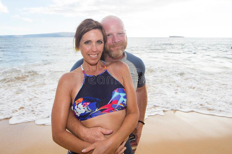 Happy couple at beach. Man and women at Hawaii beach royalty free stock images