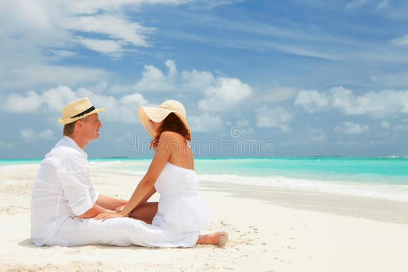 Happy couple on the beach of sea stock photography