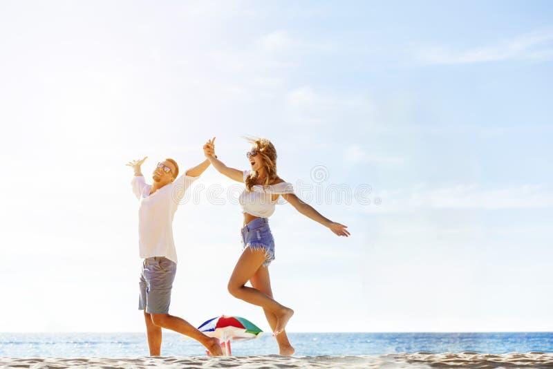 Happy couple beach tropical vatations royalty free stock photo