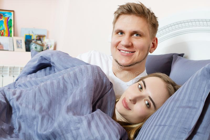 Happy couple bed bedroom in the morning, happy family, healthy sleep concept.  royalty free stock photography