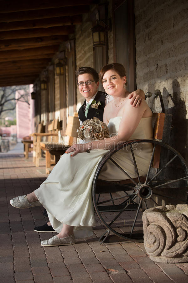Happy Couple on Bench royalty free stock photo