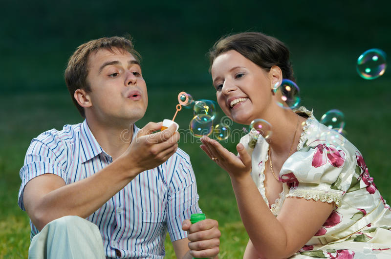 Download Happy Couple Blowing Soap Bubbles Stock Image - Image: 19995095